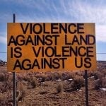 violence against land sign frack off greater chaco wildearth guardians